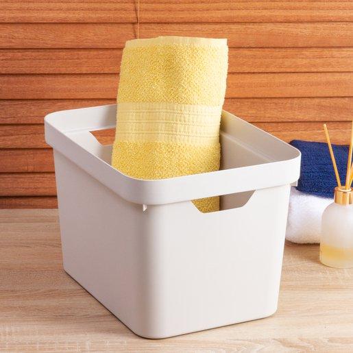 Caixa branca com toalha enrolada amarela guardada