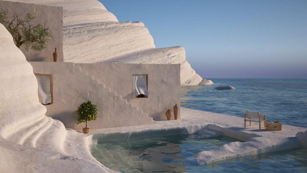 Cadeira de madeira e tecido branco de frente para o mar, com um caixote de madeira com um cinzeiro e um revista, sobre uma plataforma de areia. Atrás da cadeira, um piscina, e atrás dela, uma parede, com uma janelas com uma cortina esvoaçante, uma escada e ao pé dela dois vasos de barro. Ao fundo da imagem, uma rocha grande completa a paisagem