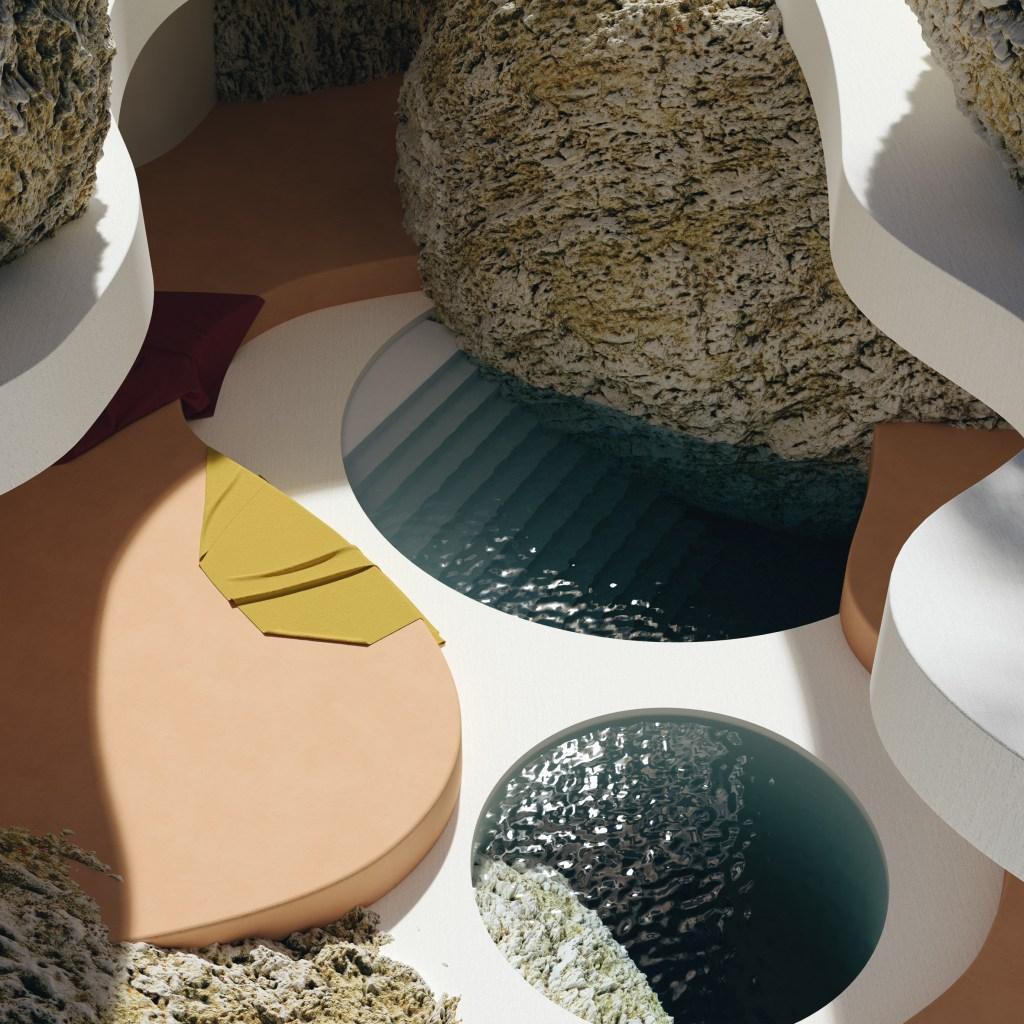 Duas piscinas, um circular e outra em meia lua, com degraus; em volta, formas circulares em tom bege e branco e rochas completam a imagem