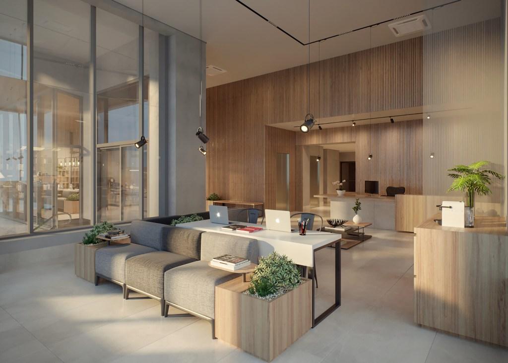 Lounge com sofás cinzas e mesa branca. Paredes com revestimento em madeira