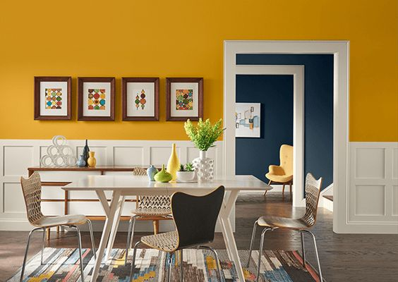parede amarela em constaste cm a decoração mais clean