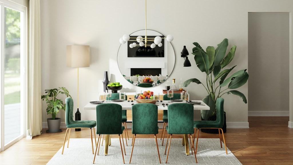 Sala de estar com cadeiras em madeira com estofado verde escuro. Mesa para oito lugares. Espelho circular na parede no centro. Luminária Sputnik