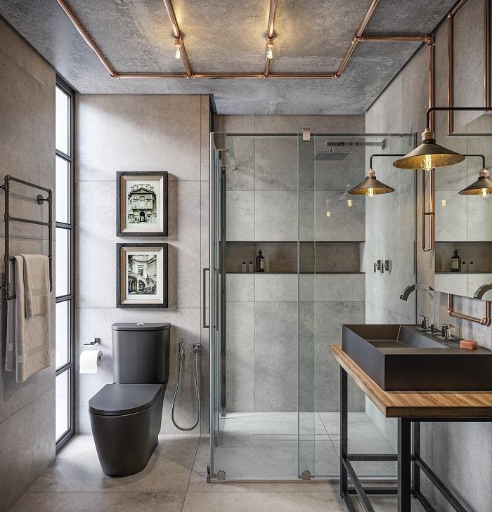 Banheiro de estilo industrial com parede de cimento queimado e tubulações expostas, cuba e bacia na cor preta